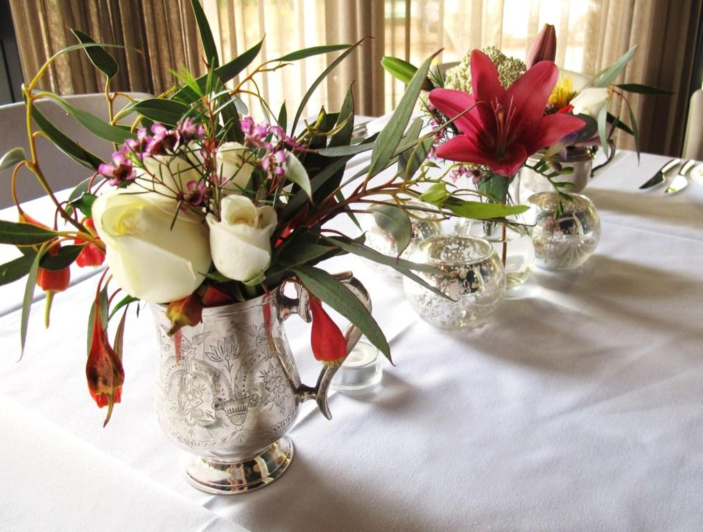 The wedding arrangements pictured are a mixture of Australian Native flowers