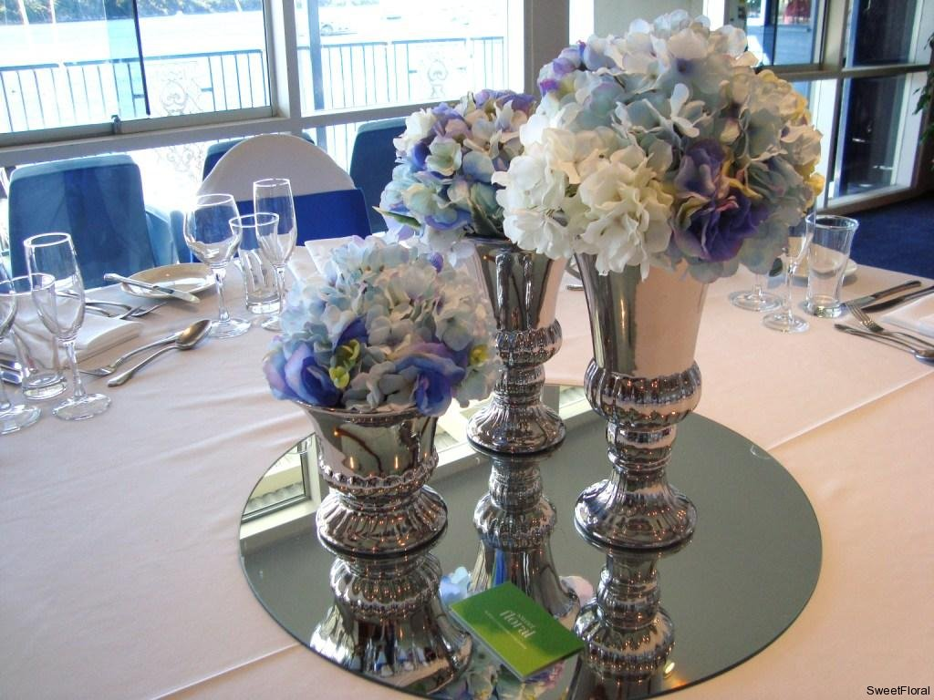 Silk Bridal Bouquets And Table Arrangements