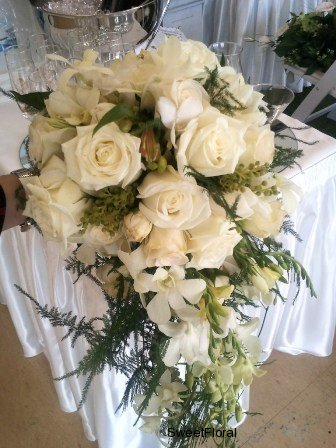 Cascading wedding bouquet of White Roses Alstroemeria and Orchids