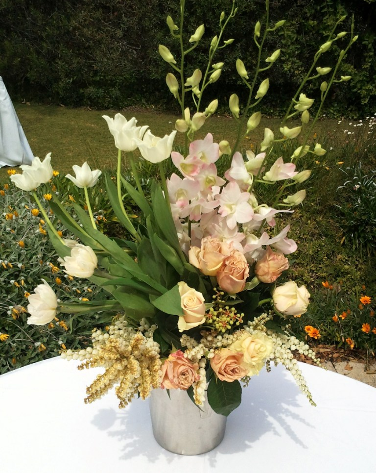 an arch display using flower to match her bridal party including pink